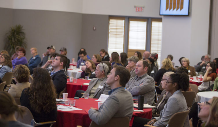 Participants listening to presentations at the food summit