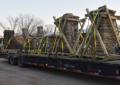 The Wheeling/Cowing monuments loaded on a flatbed for transport