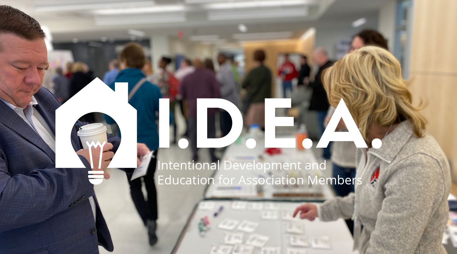 IDEA logo over a photo of the conference