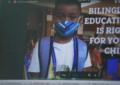 Screenshot of video showing a laptop screen advertising dual language education